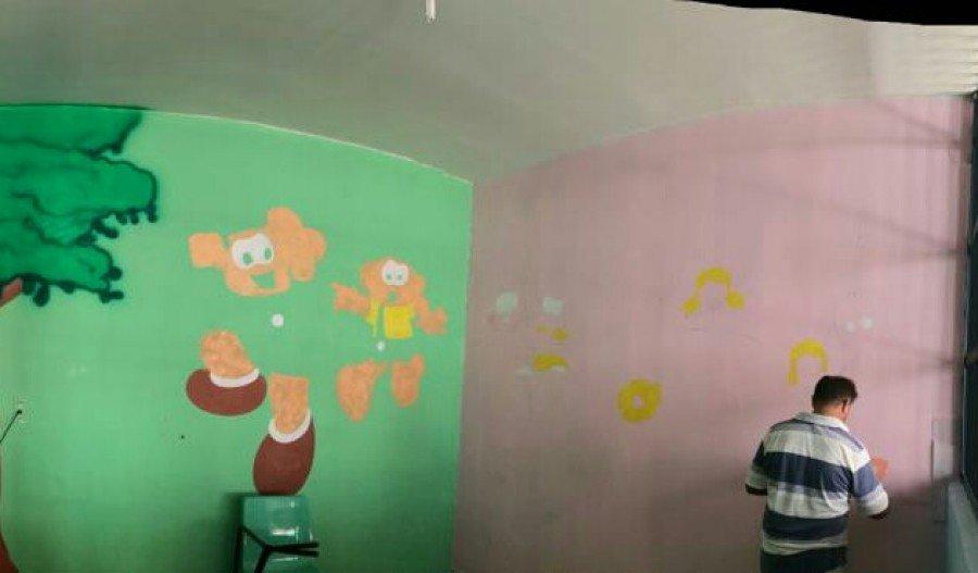 Sala de visitação para crianças sendo pintada (Foto: Divulgação)